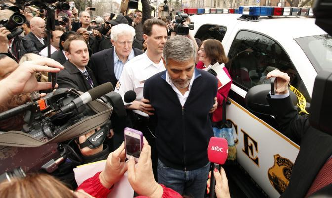 George Clooney is arrested for civil disobedience after protesting at the Sudan Embassy in Washington