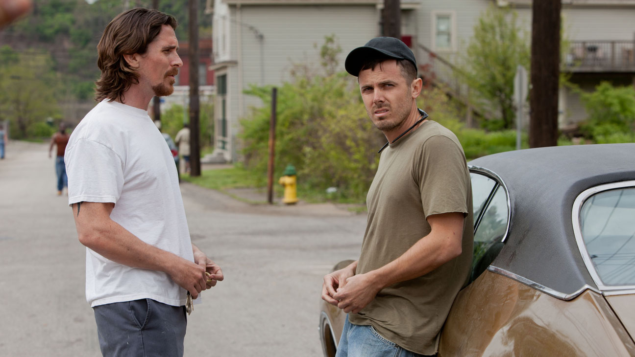 M 176 (Left to right.)  Stars Christian Bale and Casey Affleck in Relativity Media's Out of the Furnace..Photo Credit: Kerry Hayes.© 2012 Relativity Media..
