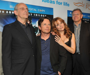 Left to Right: Neil Canton, Huey Lewis, Mary Steenburgen, Christopher Lloyd, Michael J. Fox, Lea Thompson, Robert Zemeckis and Bob Gale at the Back to the Future 25th Anniversary Trilogy Blu-ray / DVD reunion and launch party, Monday, Oct. 25, 2010, in New York, hosted by Universal Studios Home Entertainment. (Diane Bondareff/AP Images for Universal Studios Home Entertainment)