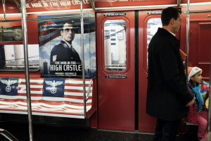 "NEW YORK, NY - NOVEMBER 24:  A New York City subway car is covered in Nazi imagery to promote the new Amazon television series ""The Man in the High Castle"" on November 24, 2015 in New York City. Amazon has decided to pull the ads, which were placed on the 42nd Street Shuttle, which runs between Times Square and the transit hub Grand Central Terminal. The ads were pulled following an outcry from passengers and social media users.  (Photo by Spencer Platt/Getty Images)"