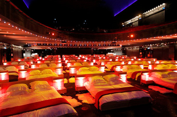 """L' OLYMPIA SE TRANSFORME EN DORTOIR GEANT POUR L' OPERATION IN BED WITH IKEA   FOR ONE NIGHT THE VENUE OLYMPIA IN PARIS WAS TRANFORMED IN A GIANT BEDROOM FOR THE NEEDS OF SWEDISH COMPANY IKEA WHO PRESENTED """"IN BED WITH IKEA AND ALLOWED SOME HAPPY FEW TO SLEEP THERE, WATCH A CONCERT OF ABBA MUSIC AND SEE MILLENIUM MOVIE THIS EVENT WAS TO PROMOTE THE LINE OF MATTRESS AND BED FROM IKEA     Angeli / Reporters Ref:  00156646_000002.jpg"""
